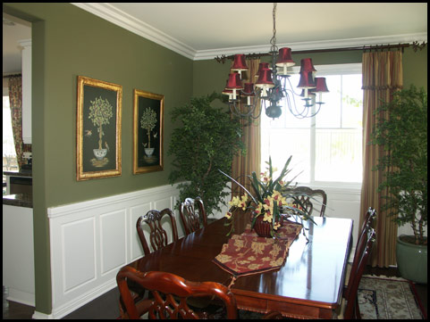Traditional dining room with wainscoting
