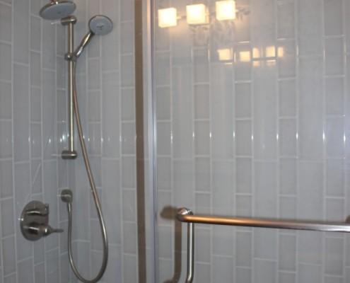 Modern shower with porcelain tile walls