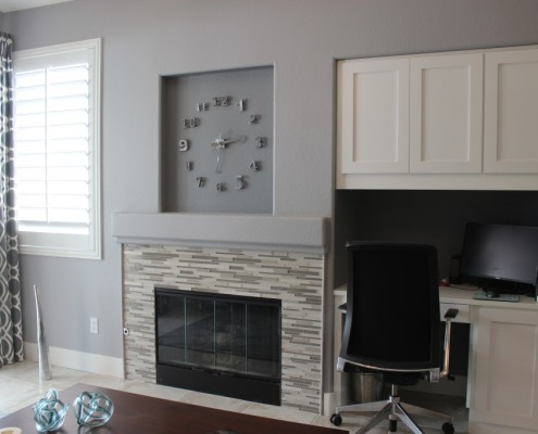Custom built in desk and glass fireplace surround