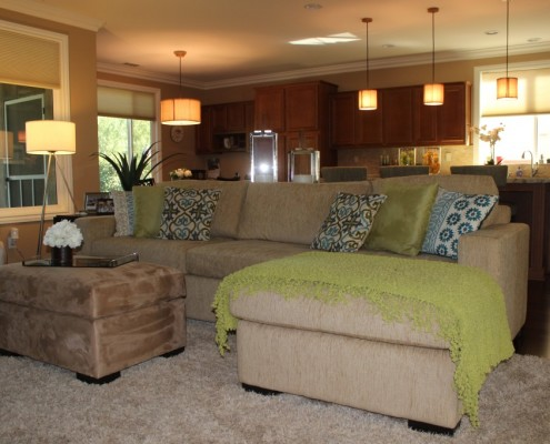 Modern living room featuring custom sectional and ottoman in Menifee, CA