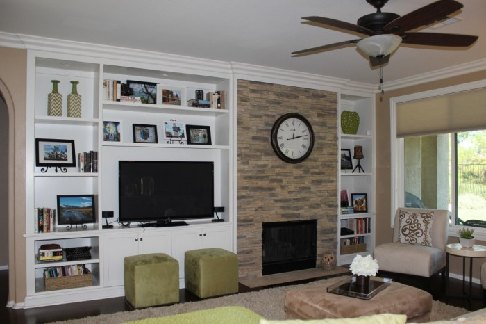 Custom cabinets and stone fireplace wall.